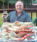 man eating crab legs
